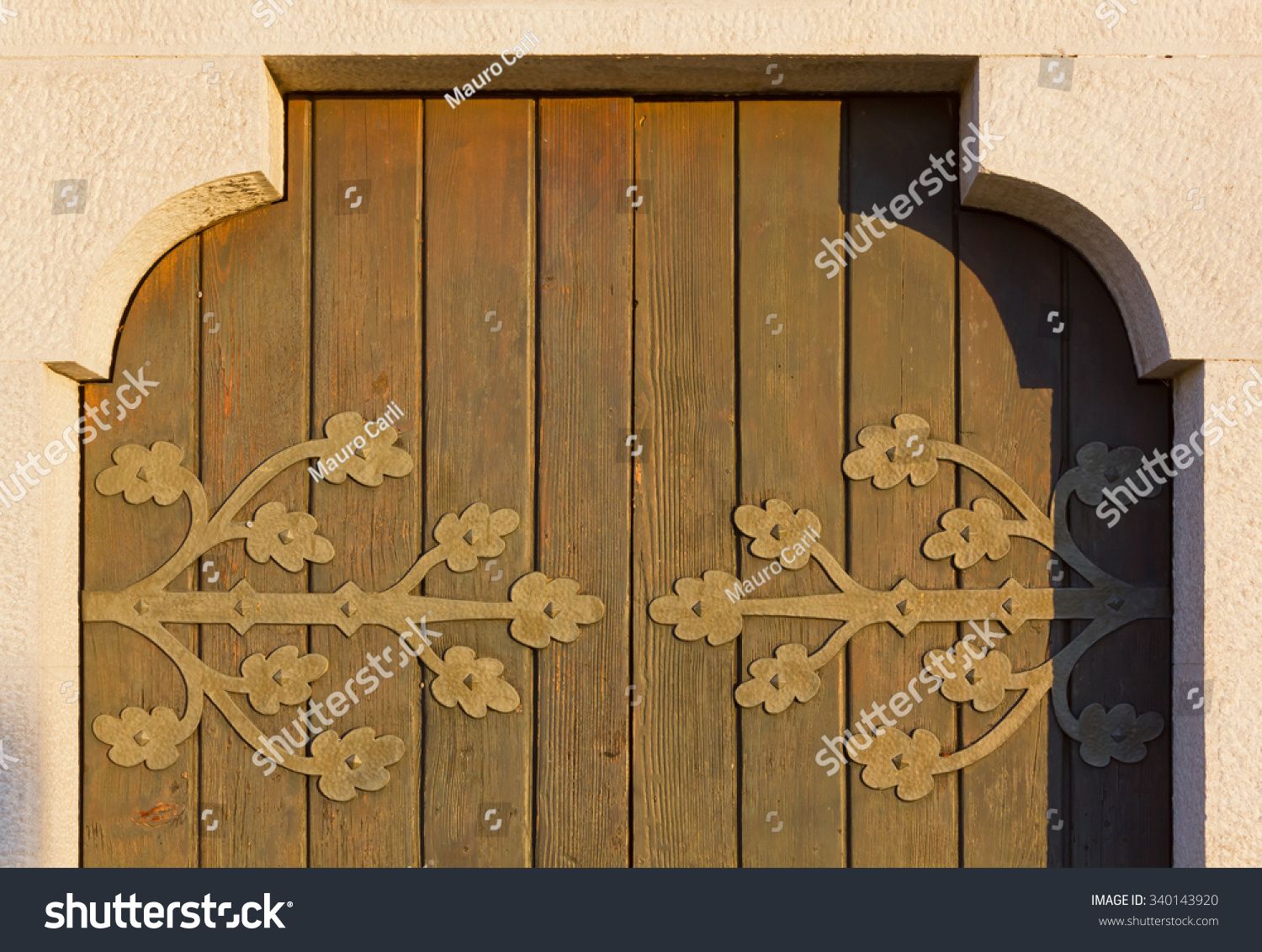 Detail Of An Old Wooden Country Church Door At Sunset