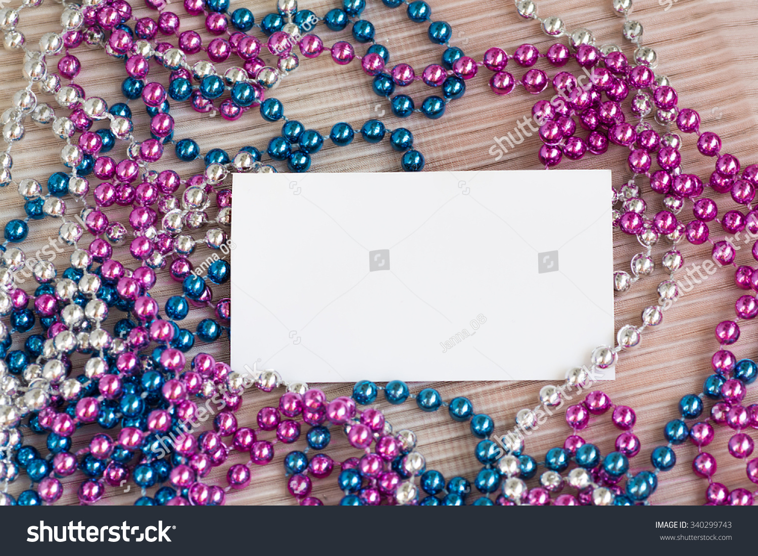 blank business card with christmas beads buy a gift for the new year buy