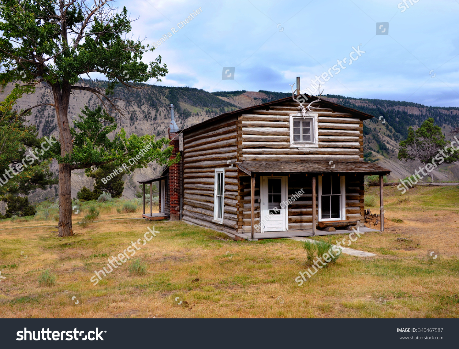 Early mail carriers cabin sits area stock photo 340467587 for Log cabins in yellowstone national park