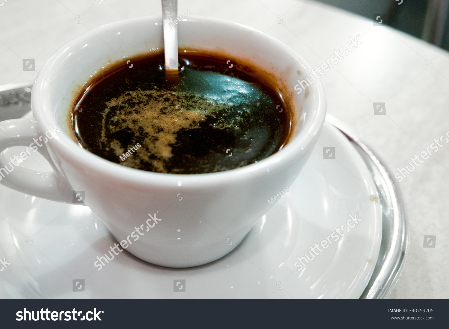 stock-photo-cup-of-black-coffee-on-the-t
