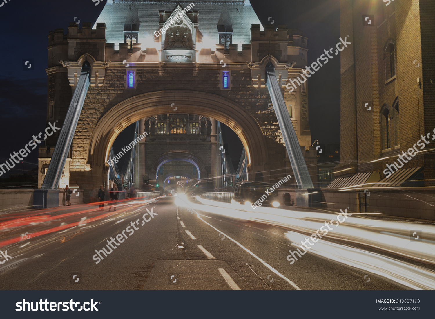 Center of Tower Bridge at night with traffic passing