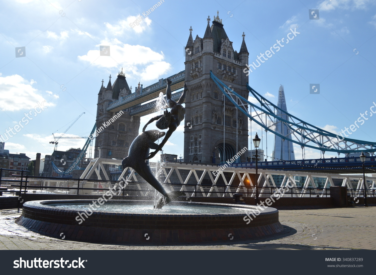 statue with London Tower Bridge in the background