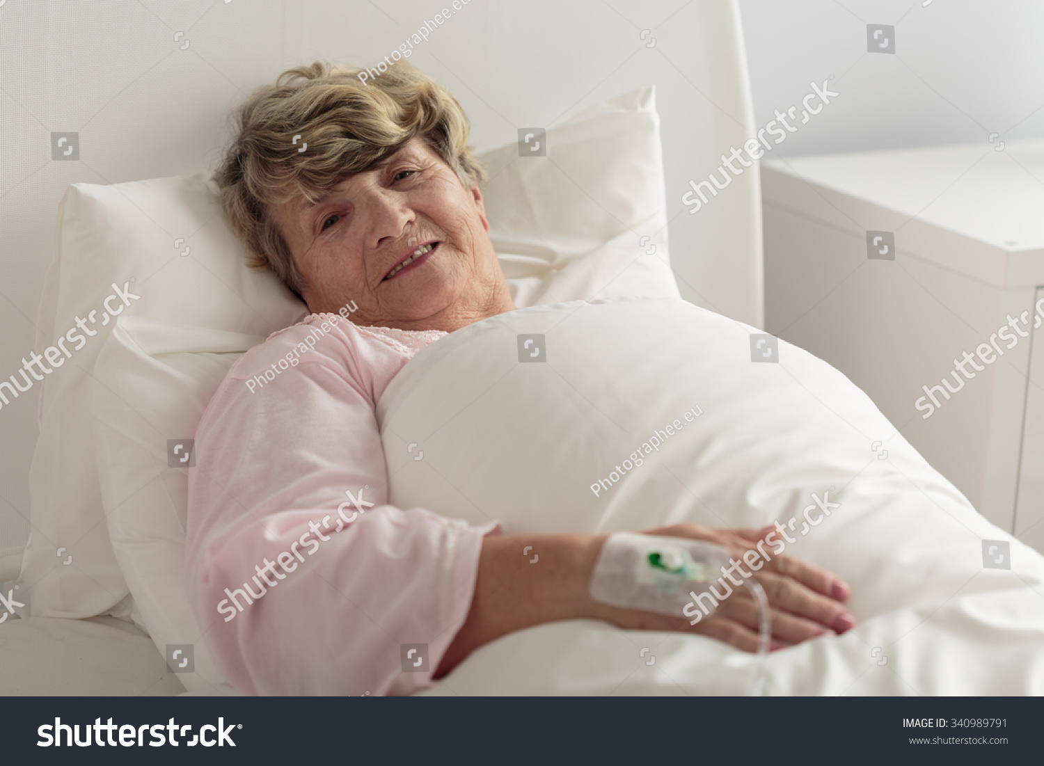 Sick In Hospital Bed Image of old sick woman lying in hospital bed ...