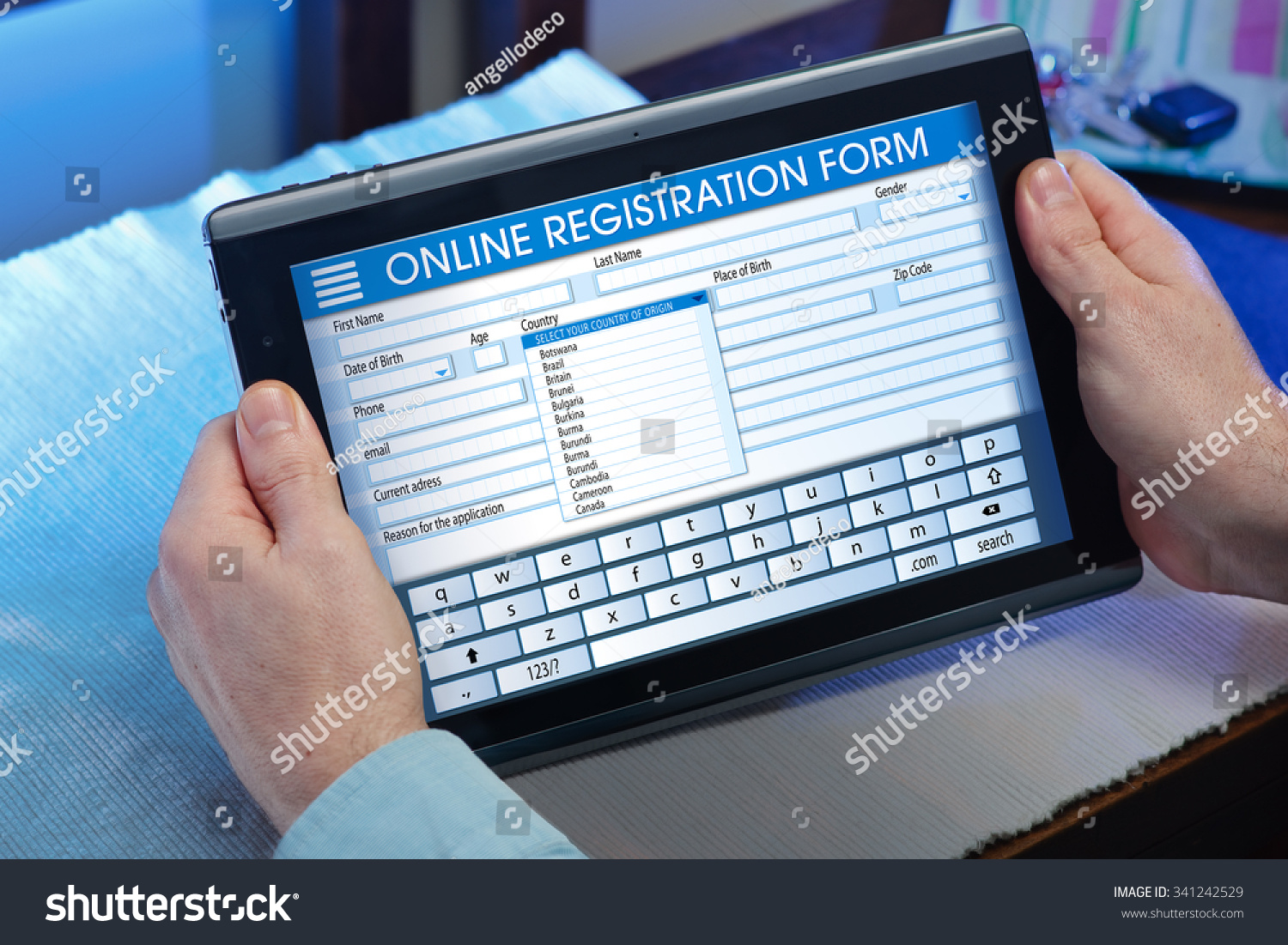 man filling out application form online stock photo  man filling out an application form online his digital tablet man at home looking