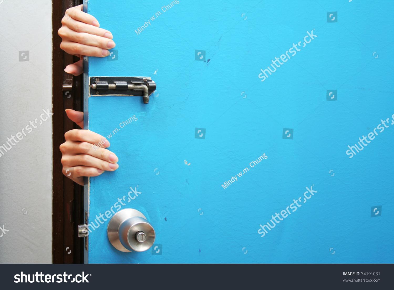 Hands behind a blue door & Hands Behind Blue Door Stock Photo 34191031 - Shutterstock pezcame.com