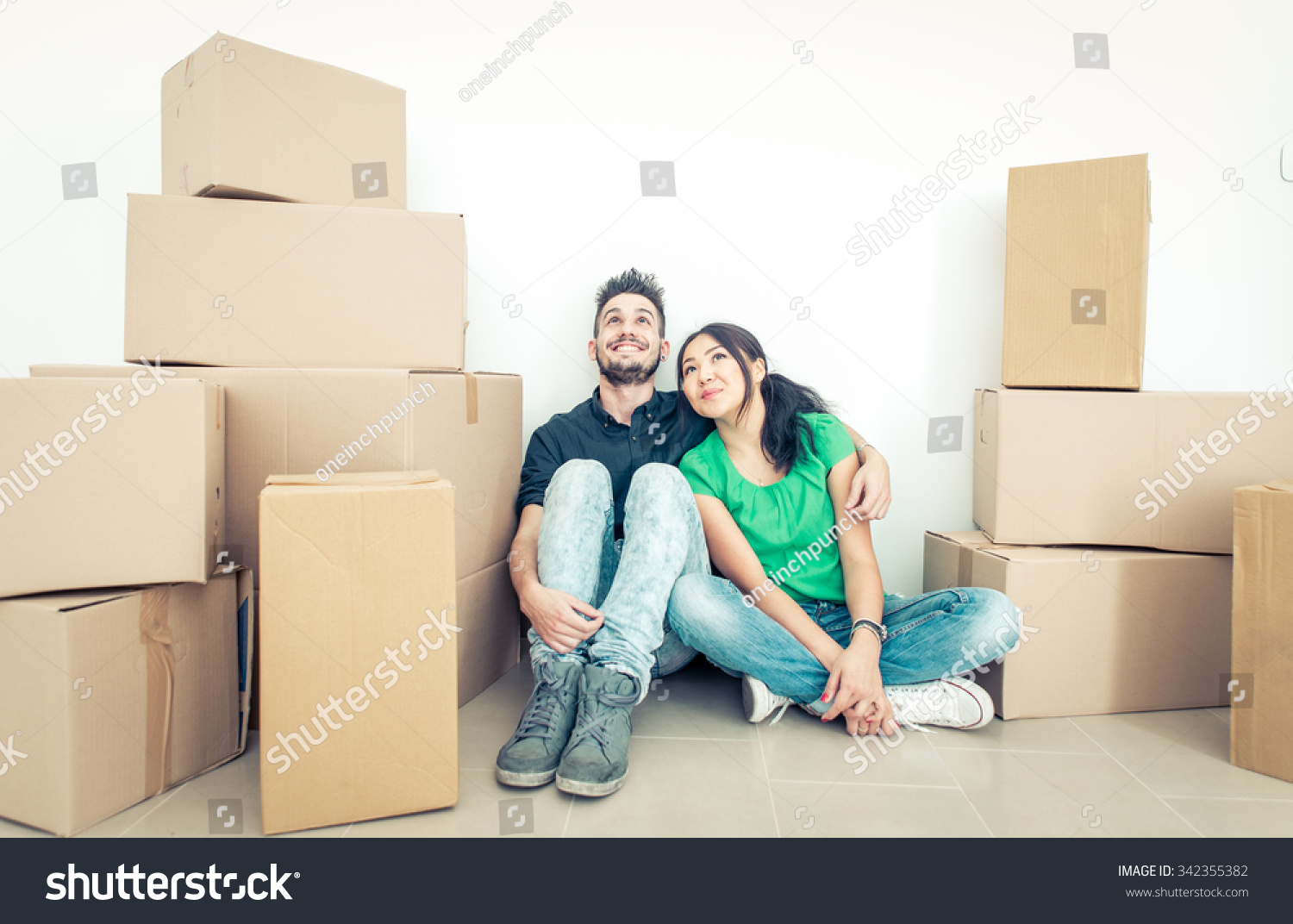 young couple moving into new apartment stock photo 342355382 shutterstock. Black Bedroom Furniture Sets. Home Design Ideas