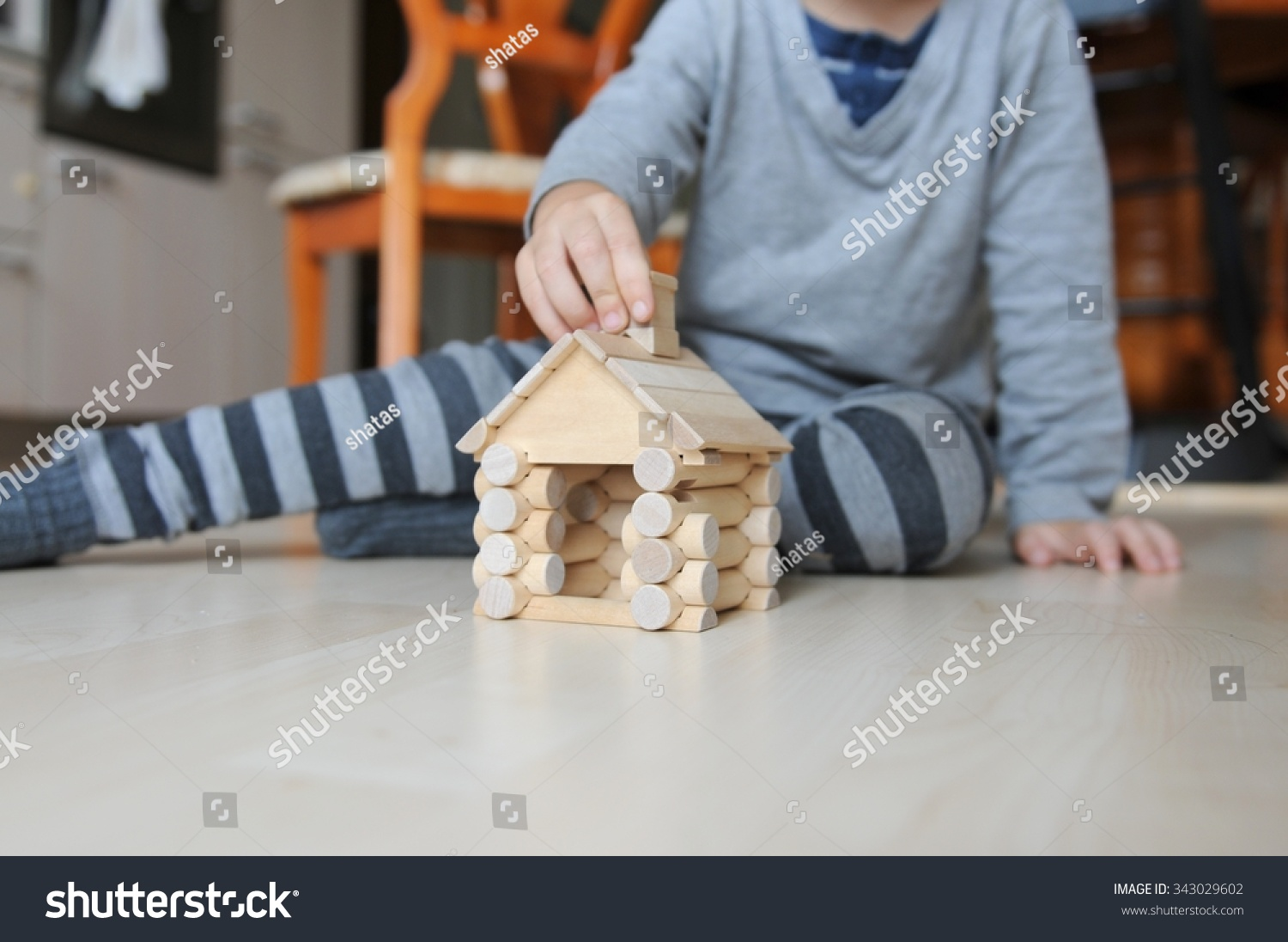 Brilliant Little Baby Building Wooden Blocks To Build Little House Stock Largest Home Design Picture Inspirations Pitcheantrous