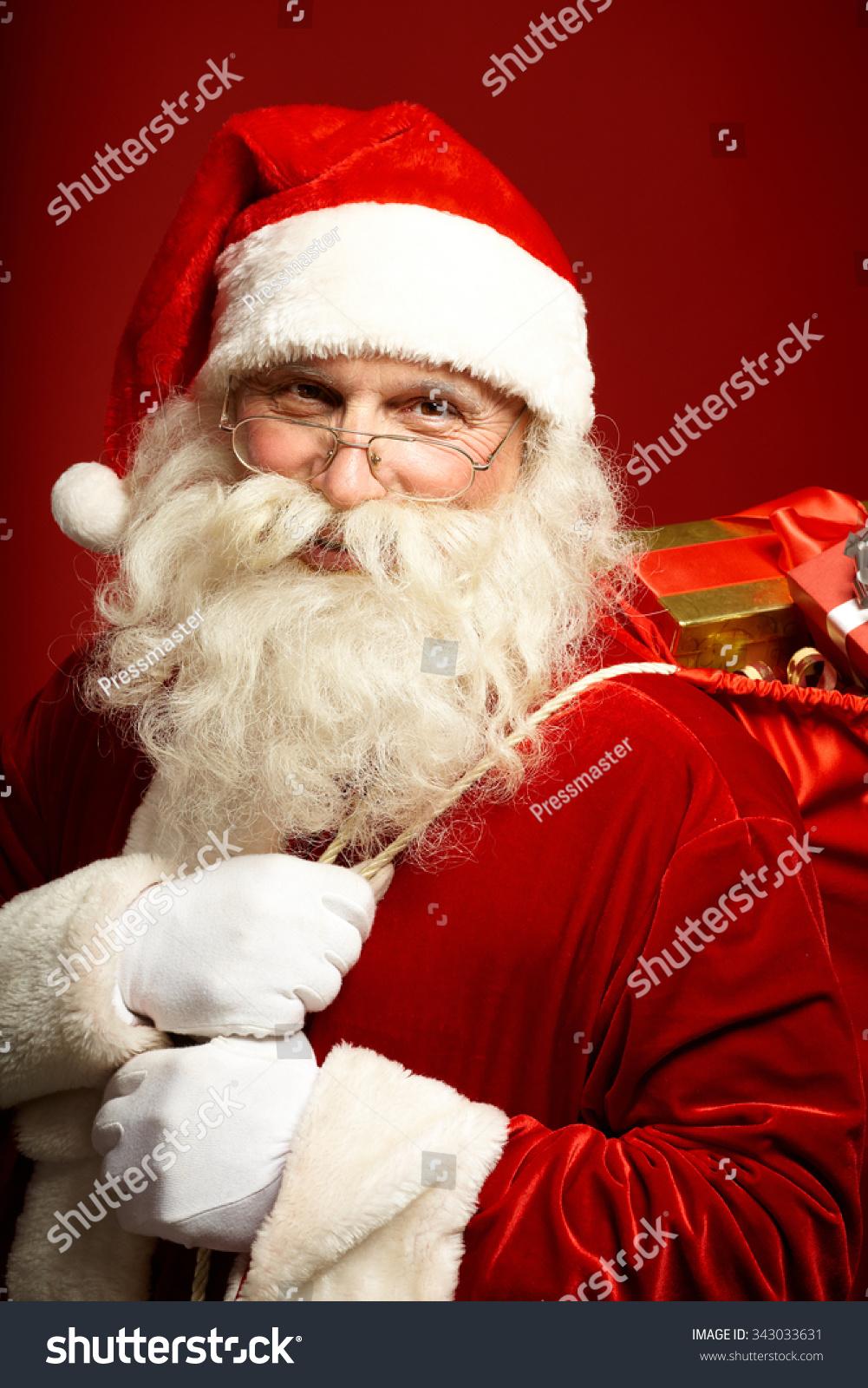 happy santa sack full christmas presents stock photo 343033631