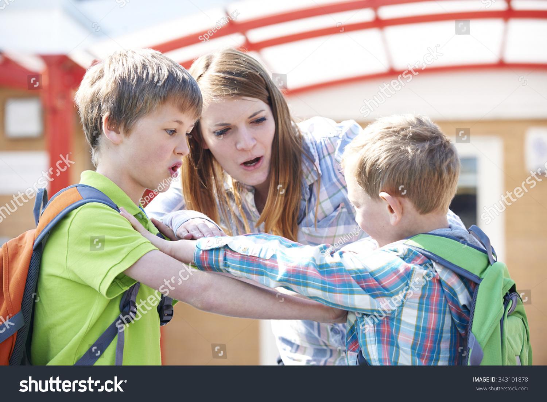 Teacher Stopping Two Boys Fighting Playground Stock Photo ...