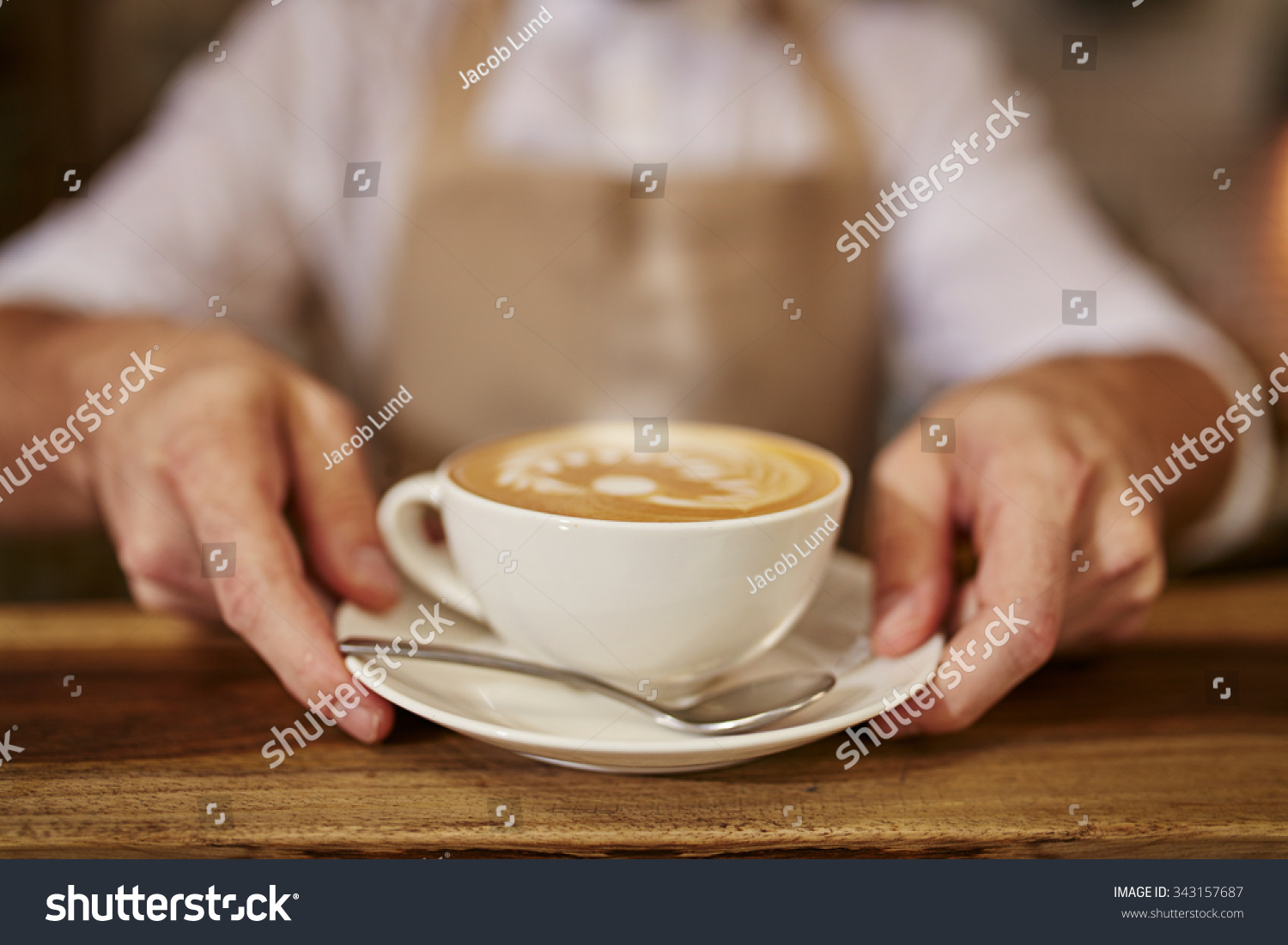 close man serving coffee while standing stock photo 343157687 shutterstock. Black Bedroom Furniture Sets. Home Design Ideas