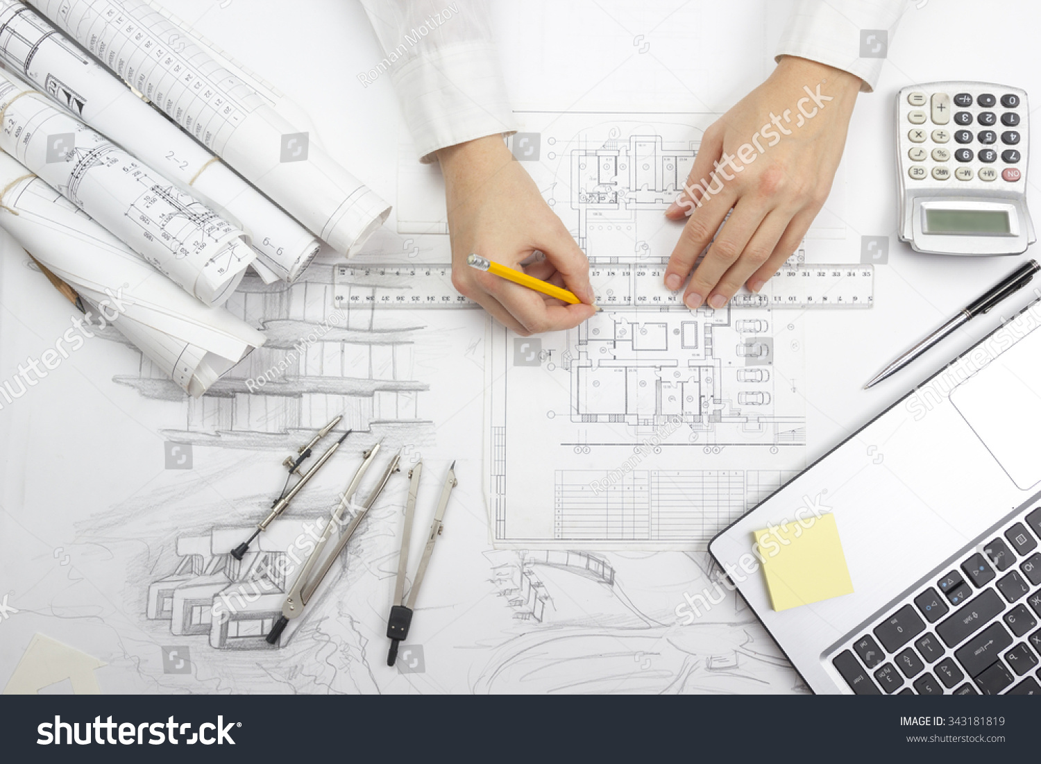 Architect working on blueprint architects workplace stock for Construction architect