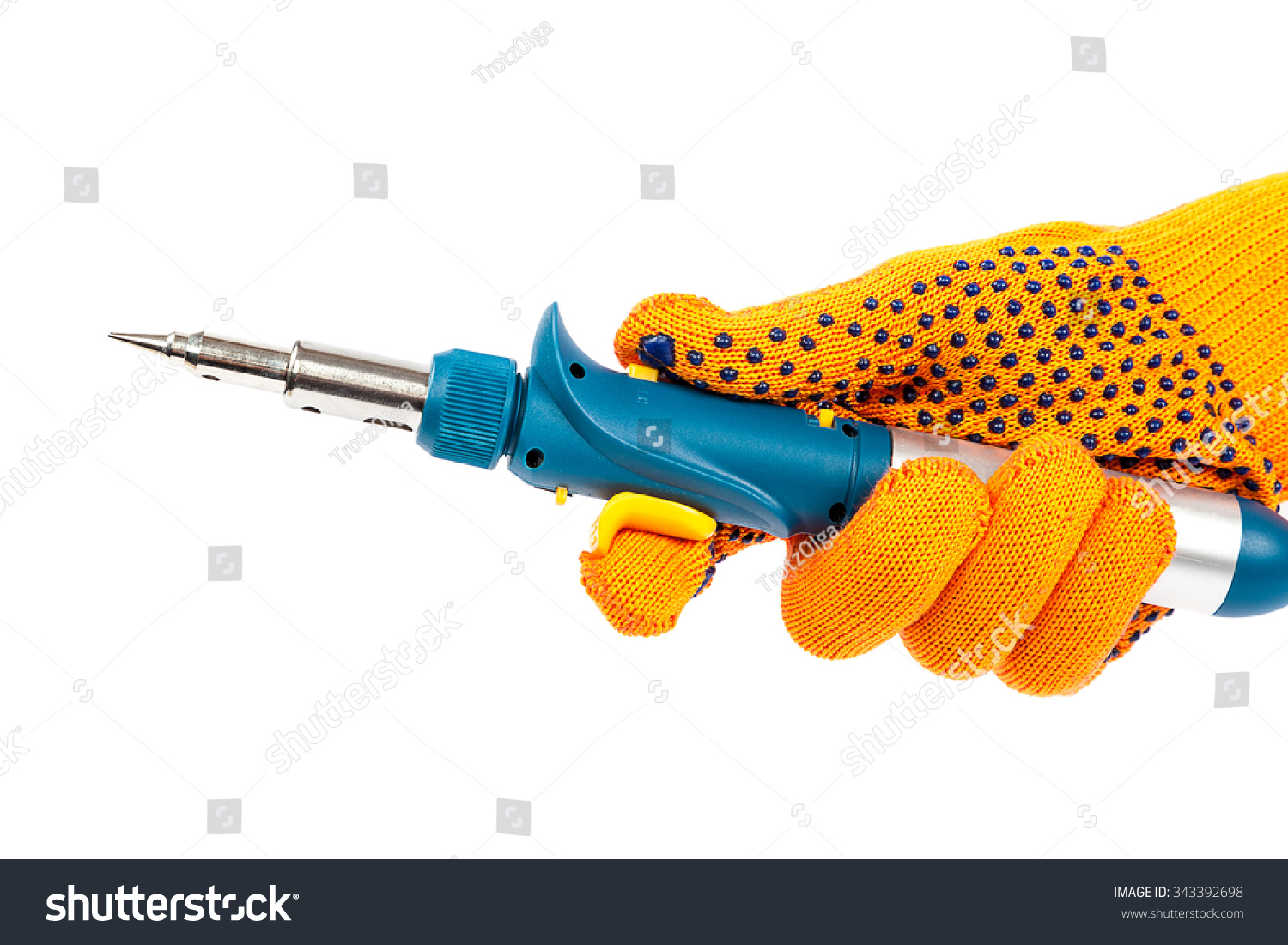 autonomous gas soldering iron in hand with protective gloves isolated on a wh. Black Bedroom Furniture Sets. Home Design Ideas