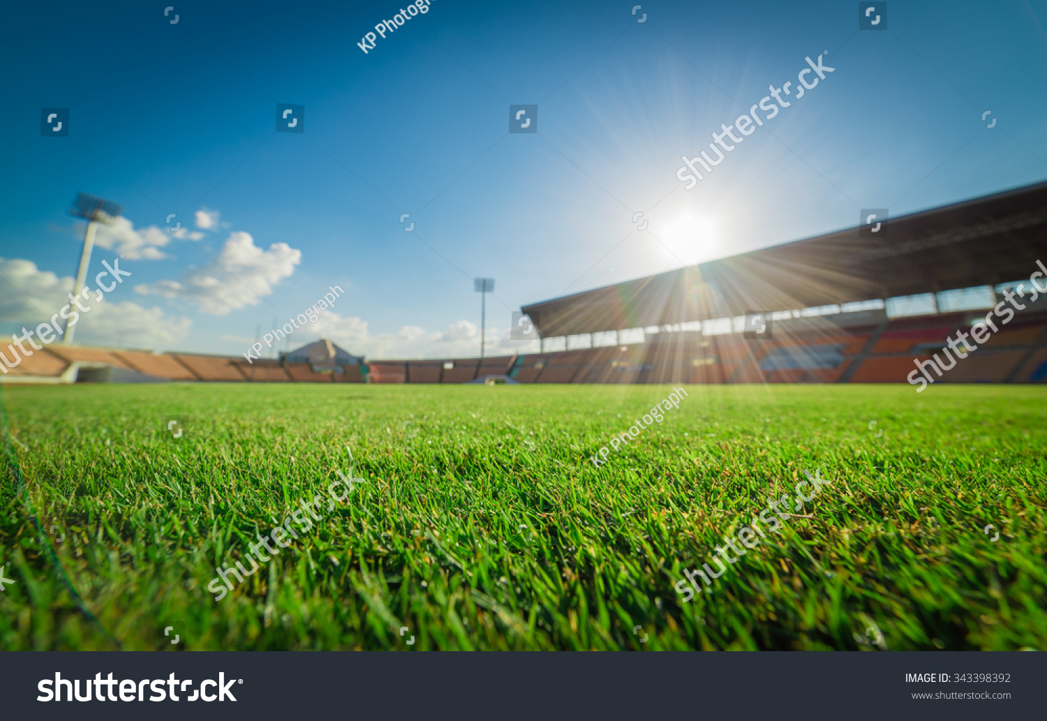 Soccer Football On Green Field With Blue Sky Background: Green Grass Soccer Stadium Soccer Field Stock Photo