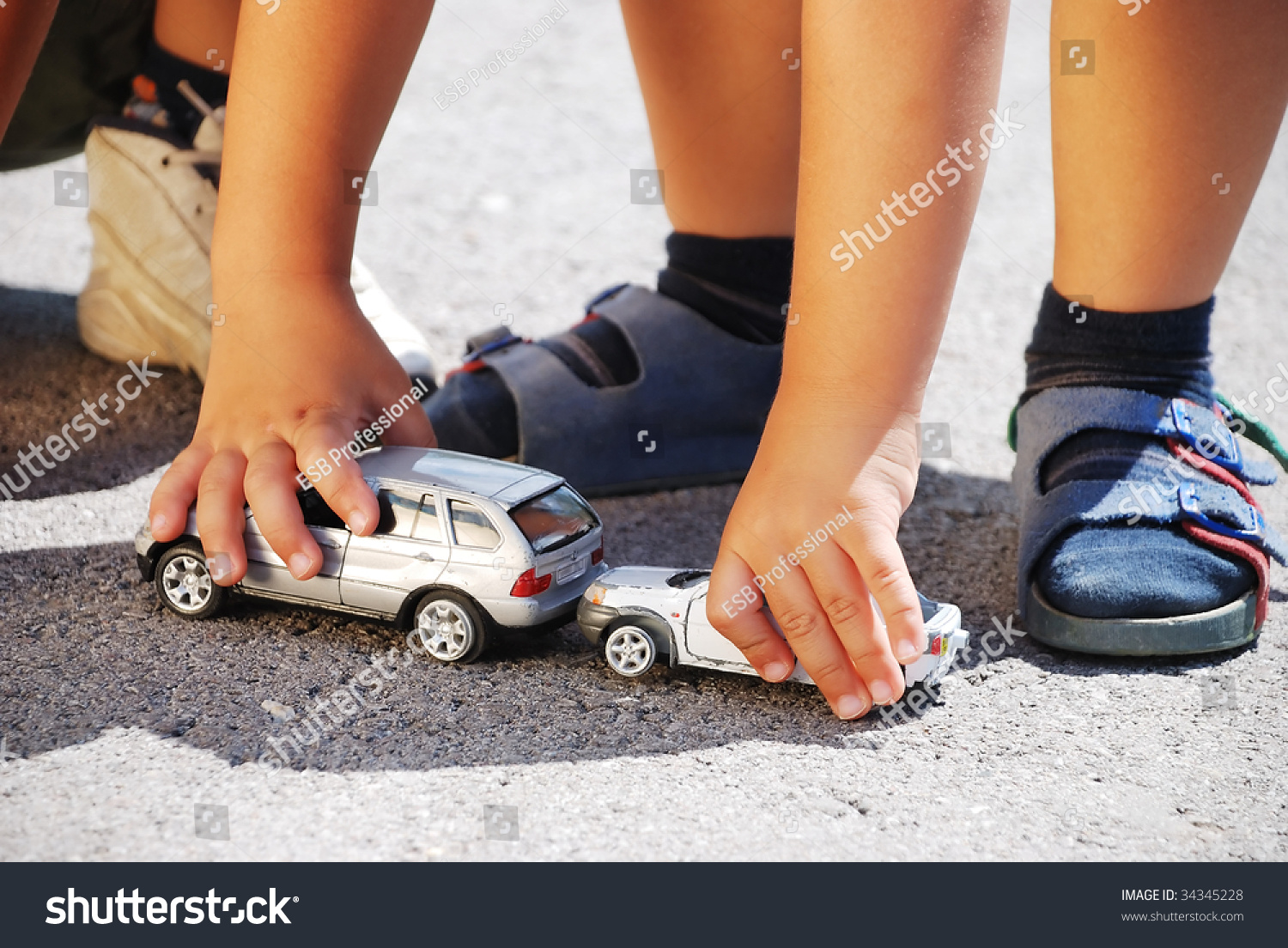 Toys For Legs : Toys cars in front of children legs stock photo