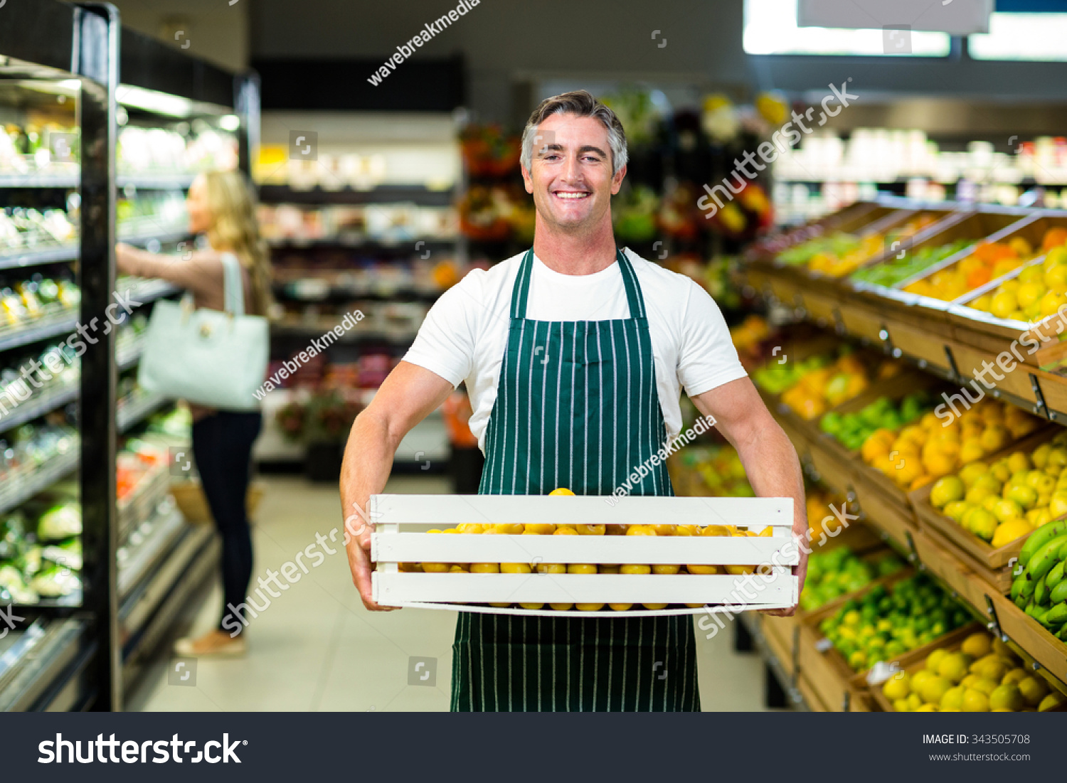 store staff stock photos images pictures shutterstock smiling worker carrying vegetables box in supermarket stock photo