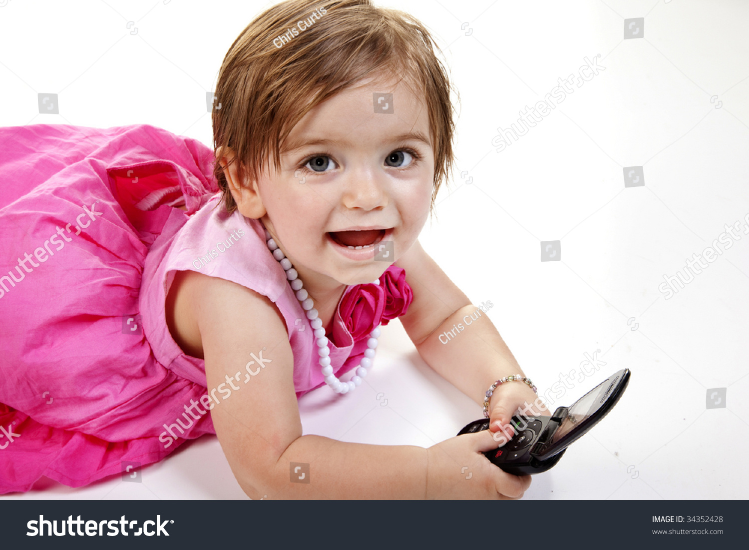 smiling cute baby girl red pink stock photo (royalty free) 34352428