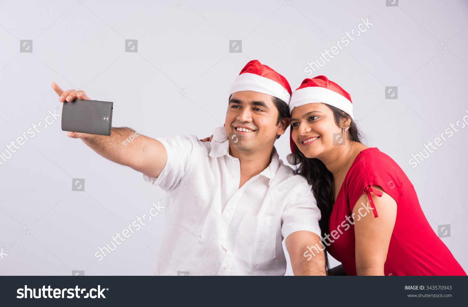 Happy Young Indian Couple Using Smartphone Stock Photo (Royalty Free ...