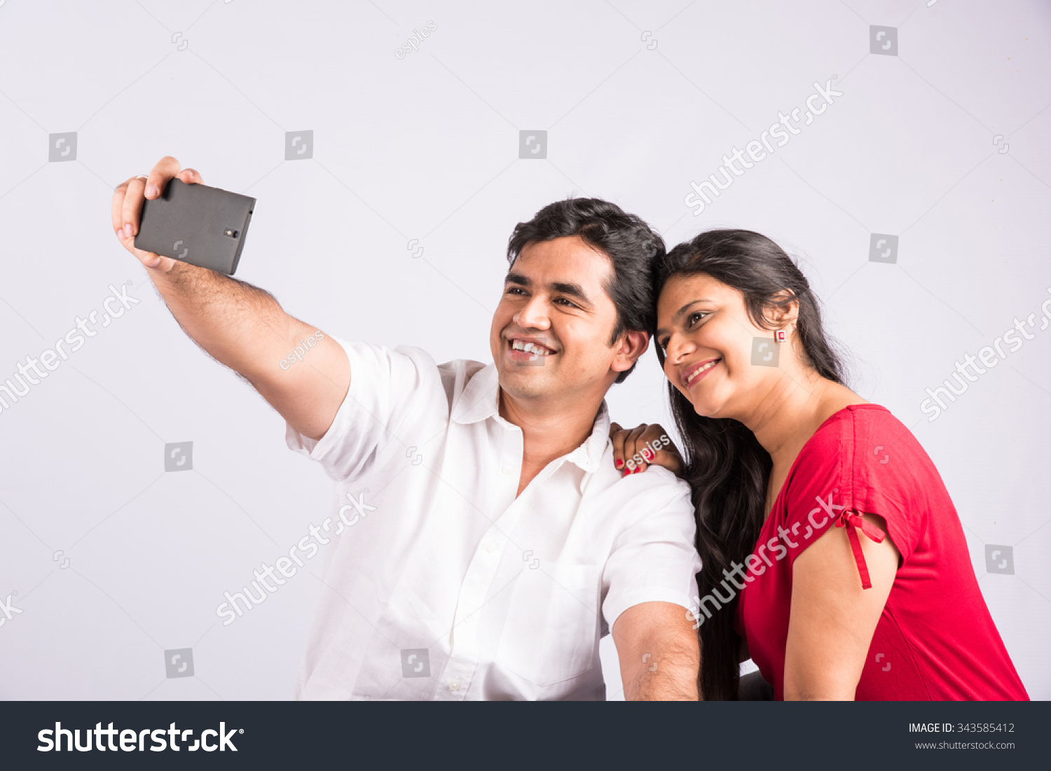 Happy Young Indian Couple Using Smartphone Stock Photo (Edit Now ...