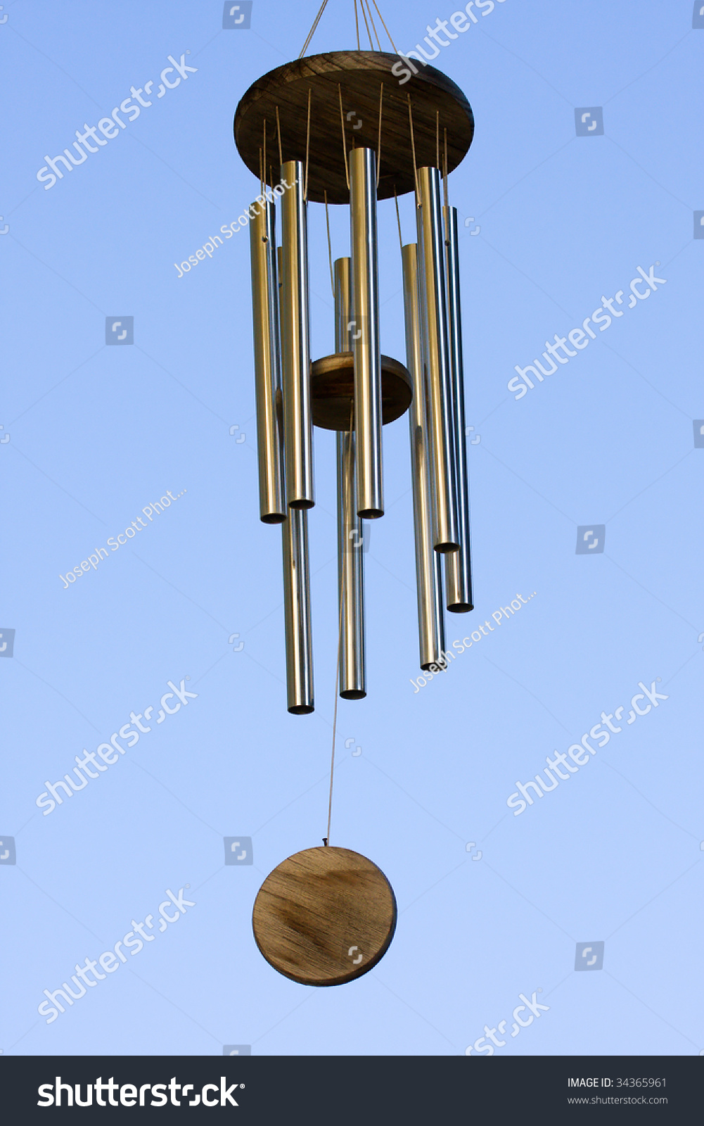 Wind Chimes Blowing In The Summer Air. Stock Photo ...