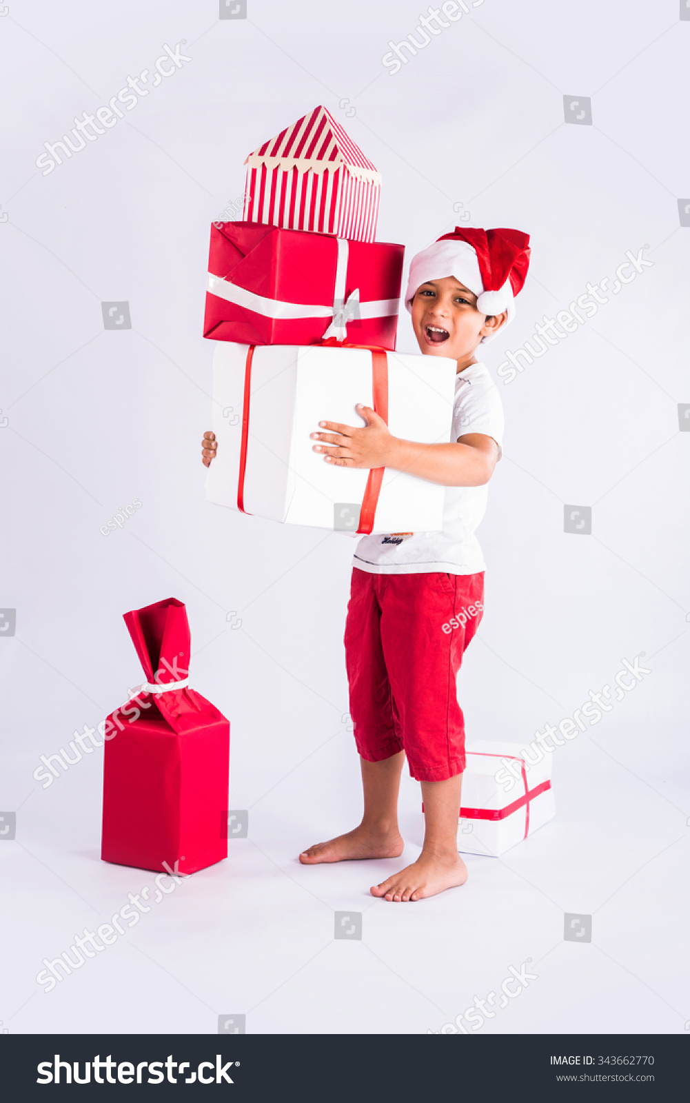 Cute Little Indian Boy Holding Christmas Stock Photo (Edit Now ...