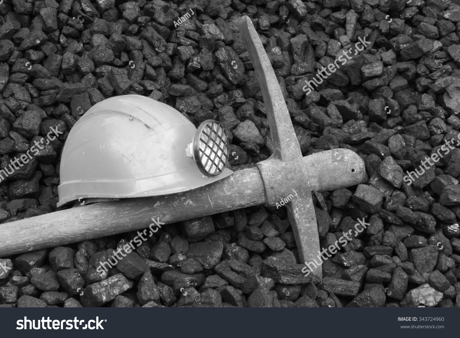 Photo helmet and pick commemorating the death of miners black and white photo