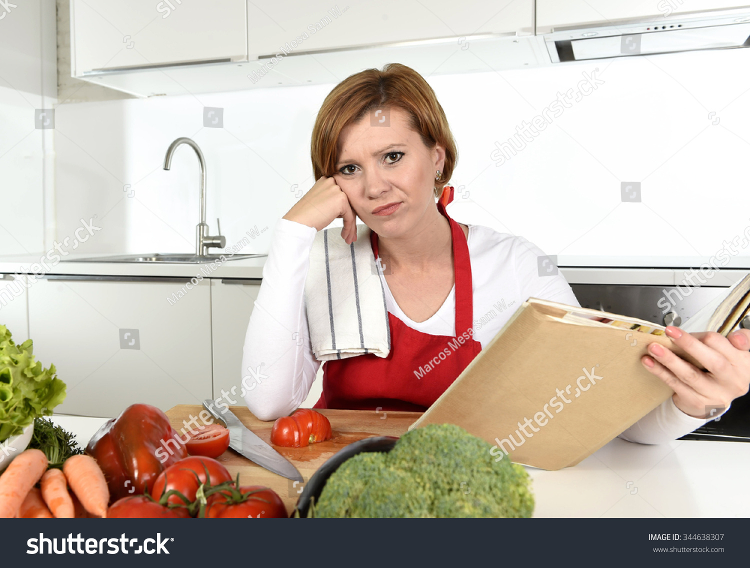 Young Beautiful Cook Woman Bored Confused Stock Photo (Royalty Free ...