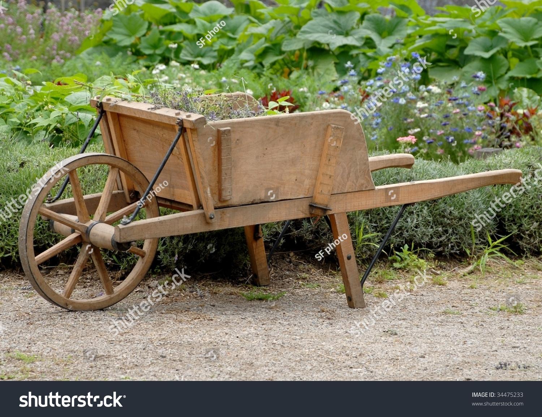 Wooden Wheelbarrow Garden Stock Photo (Edit Now) 34475233 - Shutterstock
