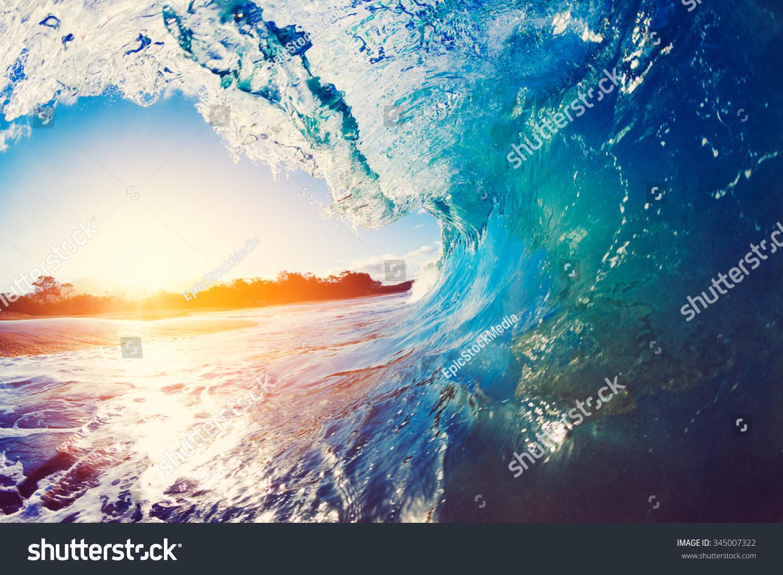Blue Ocean Wave Crashing at Sunrise #345007322