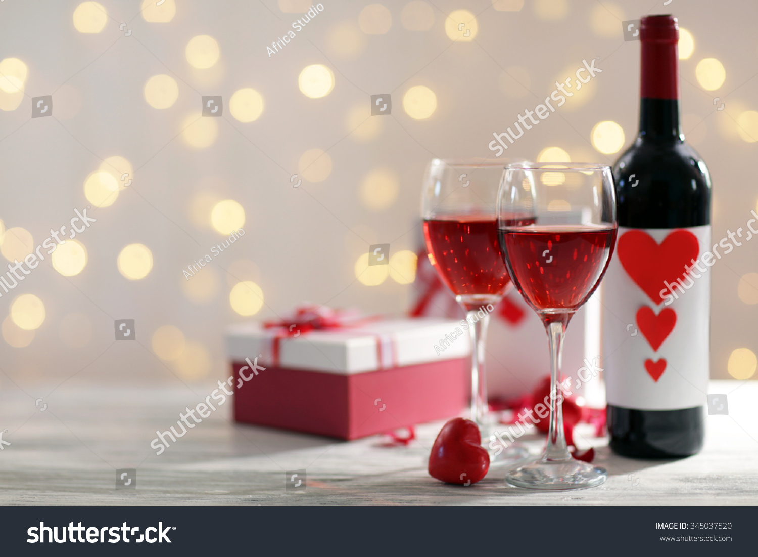 Setting of glasses with wine bottle and a gift in the box on white & Setting Glasses Wine Bottle Gift Box Stock Photo 345037520 ... Aboutintivar.Com