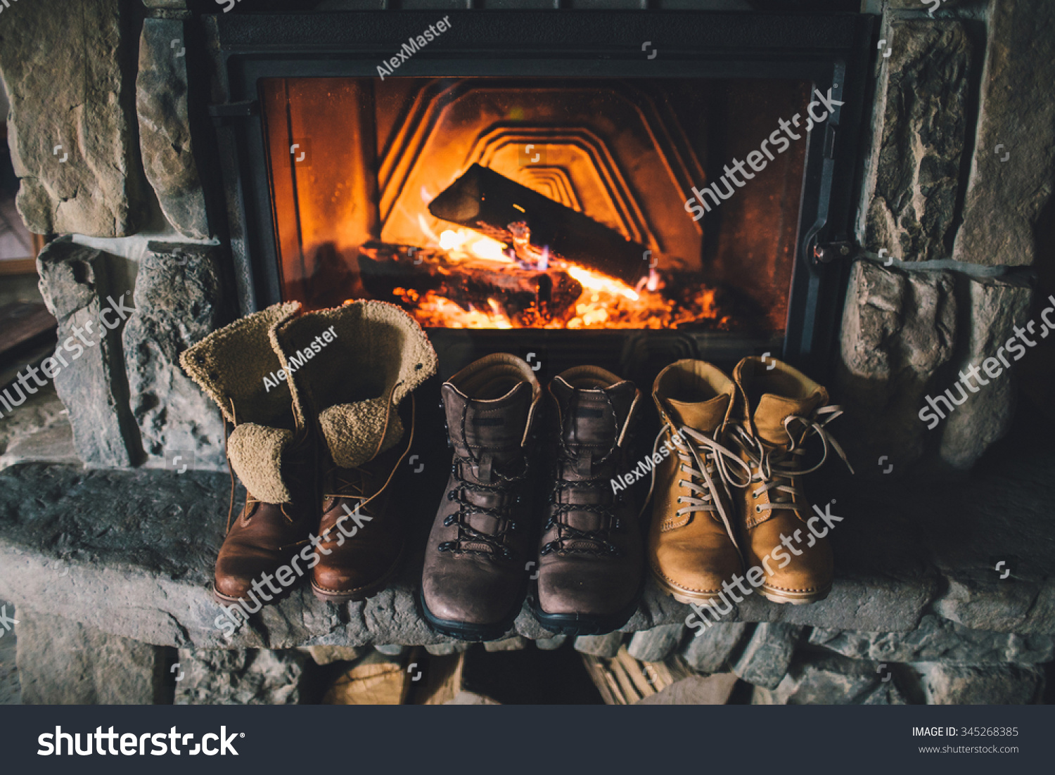 royalty free winter boots in front of a fireplace u2026 345268385