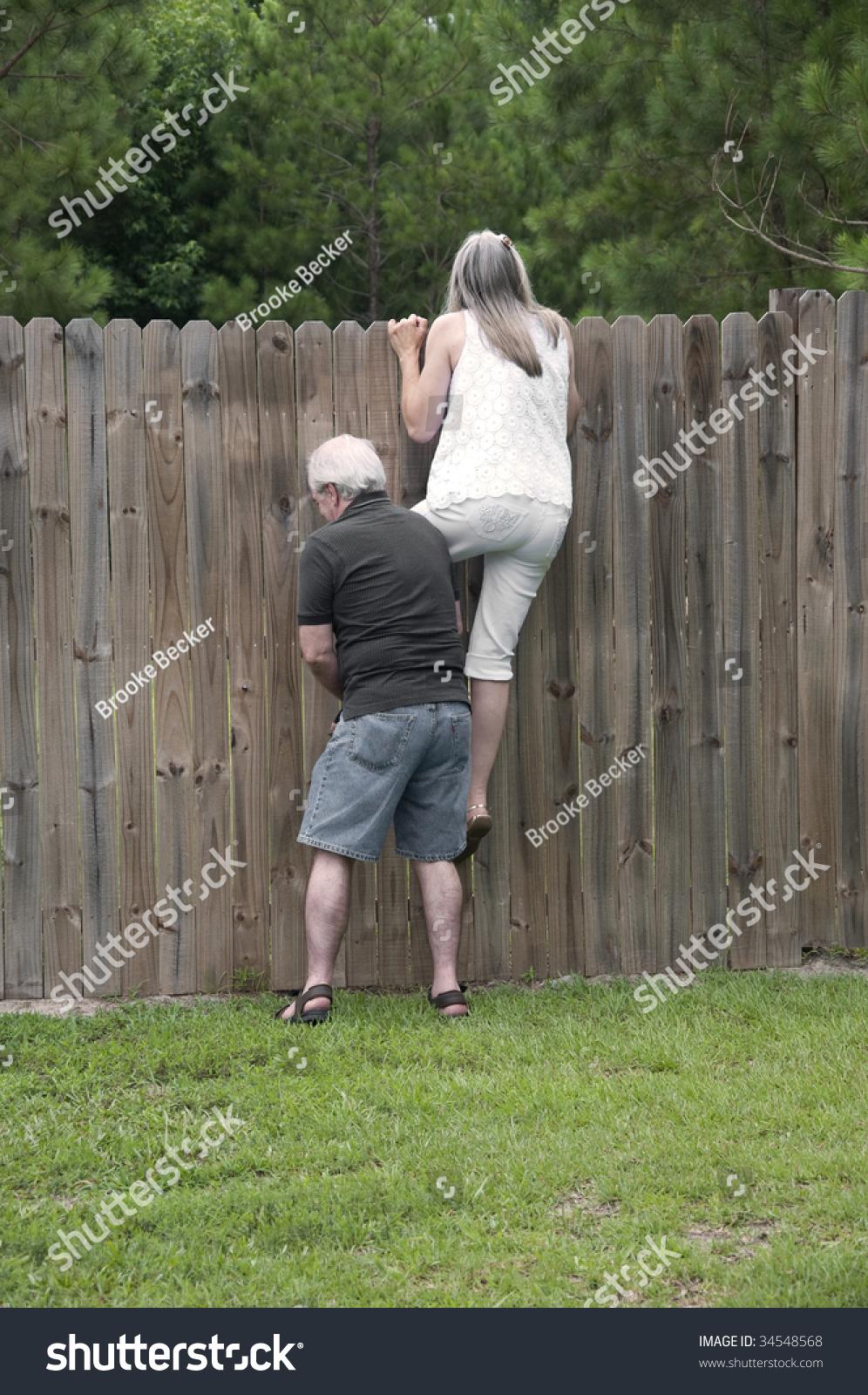 Her Husband Helps Her Peek Over Stock Photo 34548568