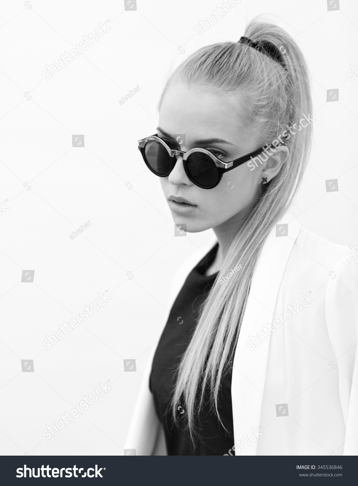 Beautiful blonde girl with sunglasses in black and white