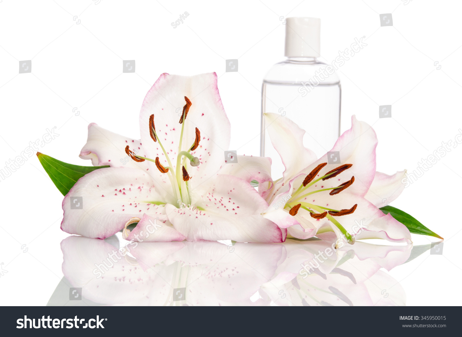 Tonic for skin care with lily flower on a white background ez canvas izmirmasajfo