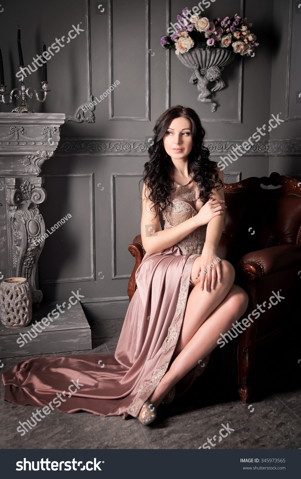 Woman sitting armchair long beige dress stock photo for Sitting in armchair