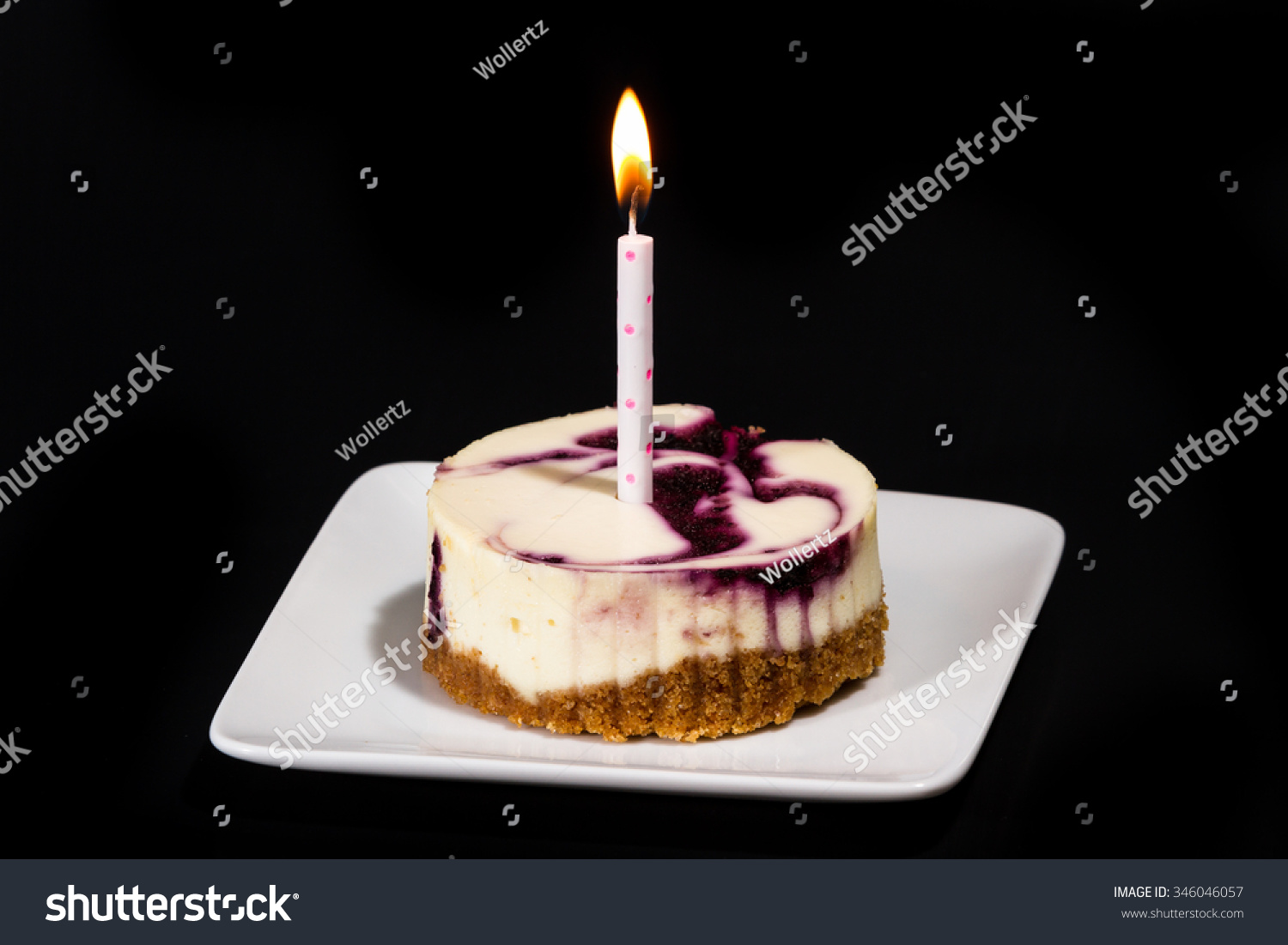 Individual Serving Huckleberry Cheesecake Birthday Candle Stock