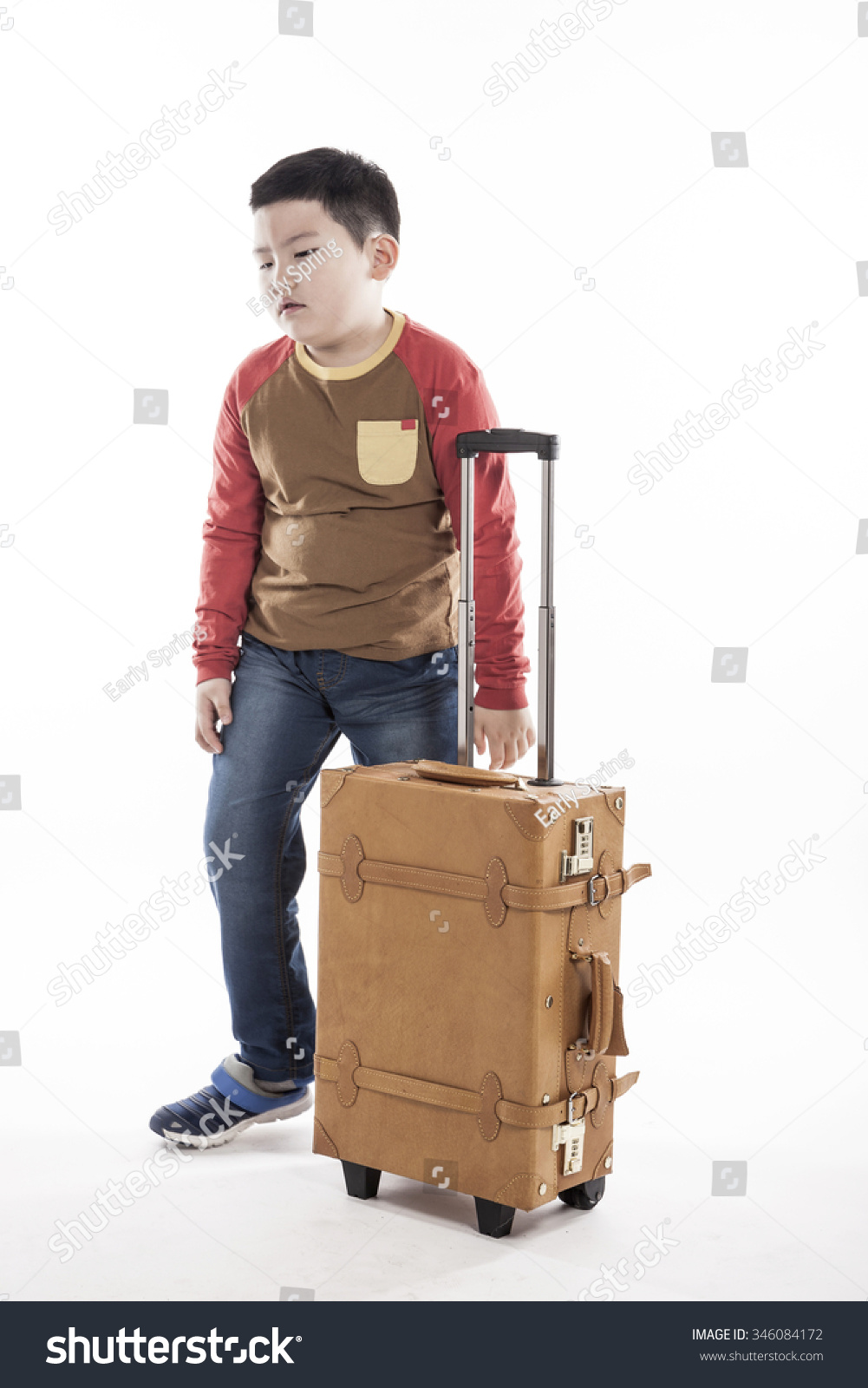 A asian(korean, japanese, chinese) boys(kid, student, child, man, male)  stand up and so tired with a luggage(suit case), stress for tour, journey  isolated ...