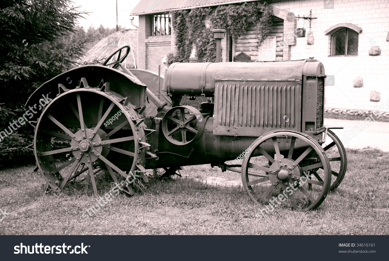 Iron Tractor Wheels : Old tractor with iron wheels is thrown on a roadside stock