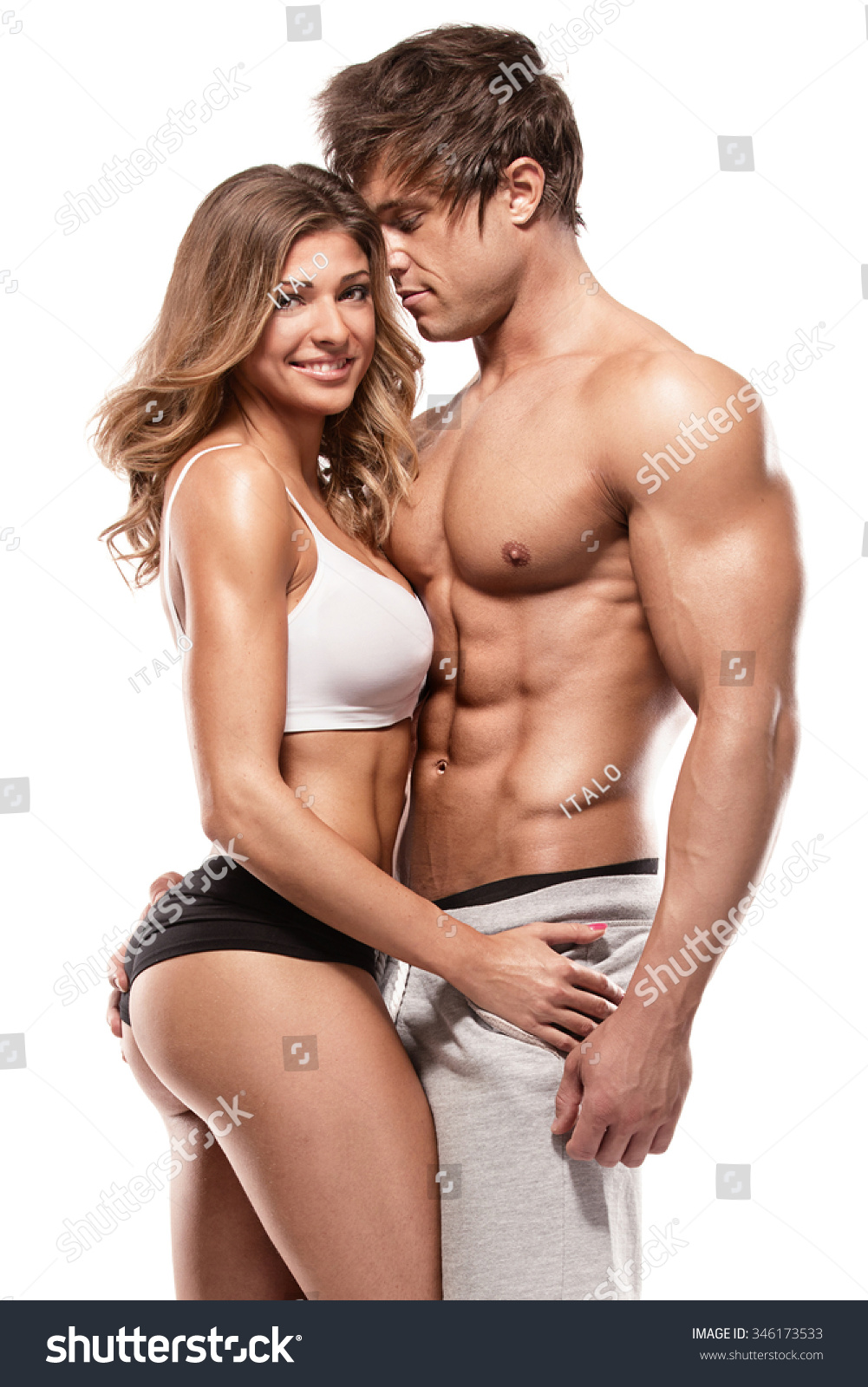 Muscl guy around sexy girls holding them Sexy Couple Muscular Man Holding Beautiful Stock Photo Edit Now 346173533