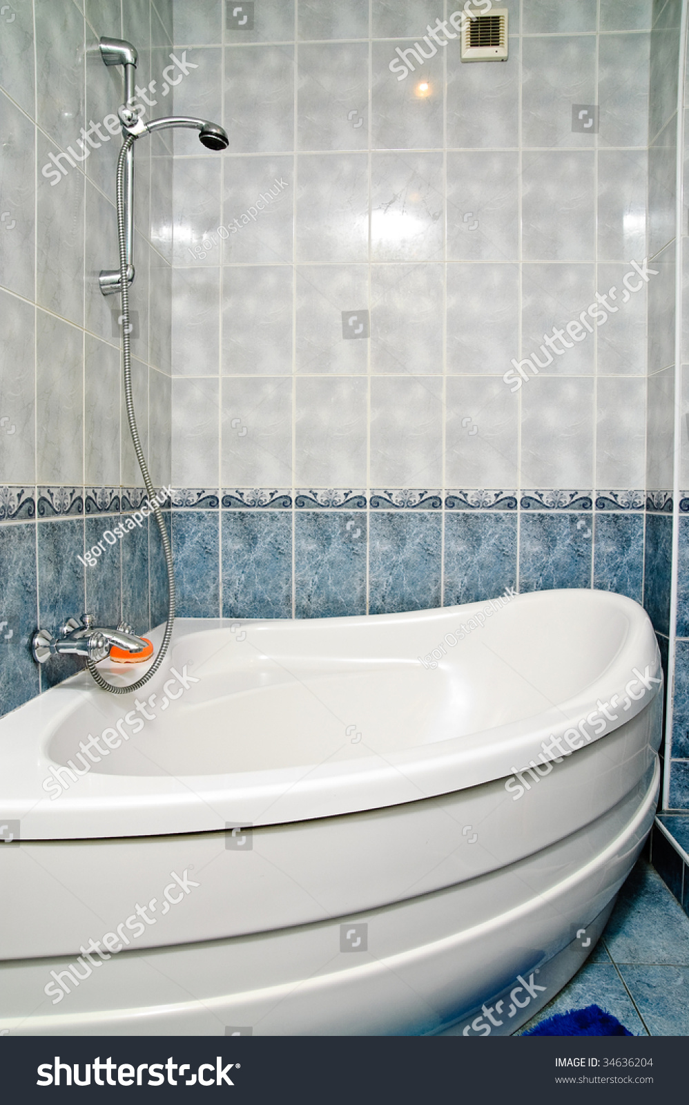Bathtub and shower in a tiled bathroom | EZ Canvas