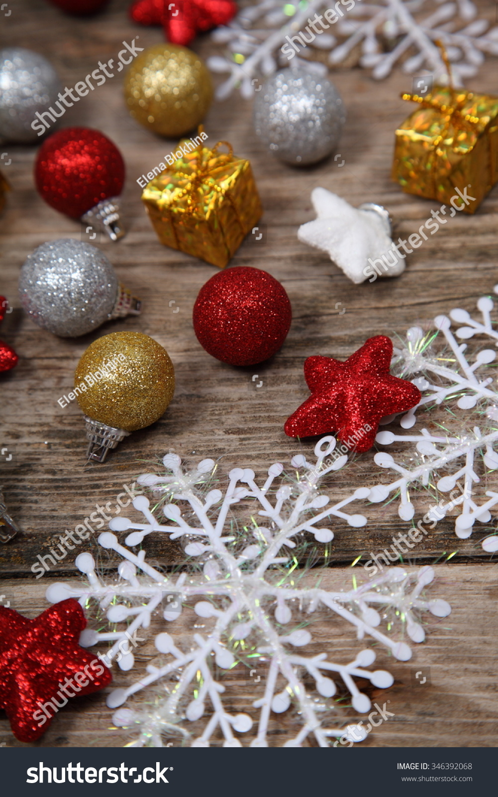 Christmas decorations. Balls, gifts and snowflakes on an old wooden ...