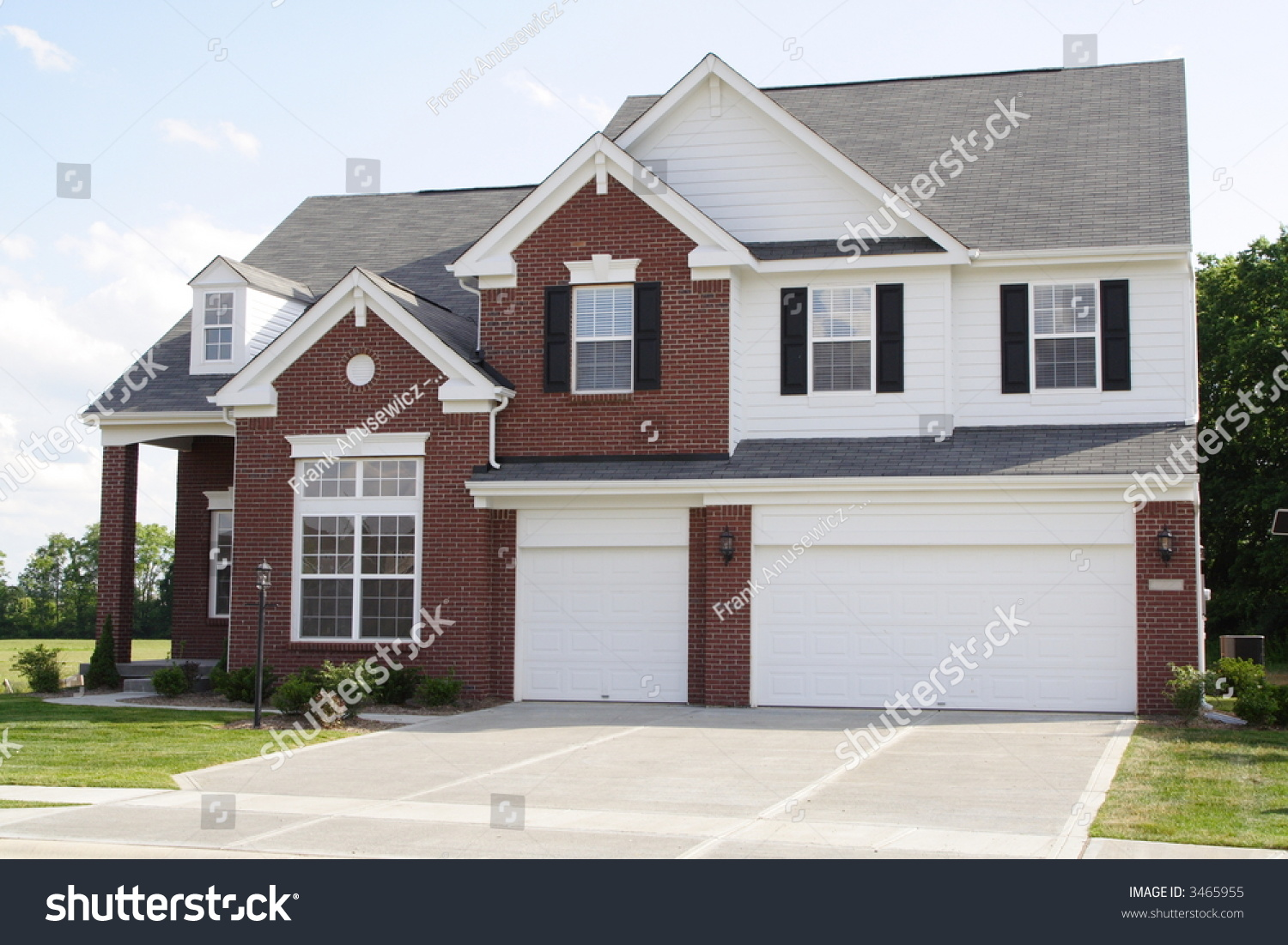 New 2 story brick home with 3 car garage stock photo for Brick garages prices