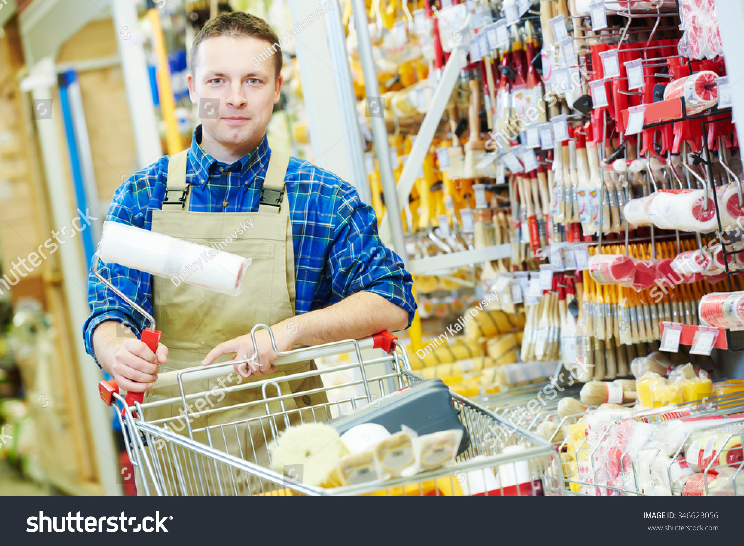 happy hardware store worker painter buyer stock photo  happy hardware store worker or painter buyer customer shopping cart looking at the camera