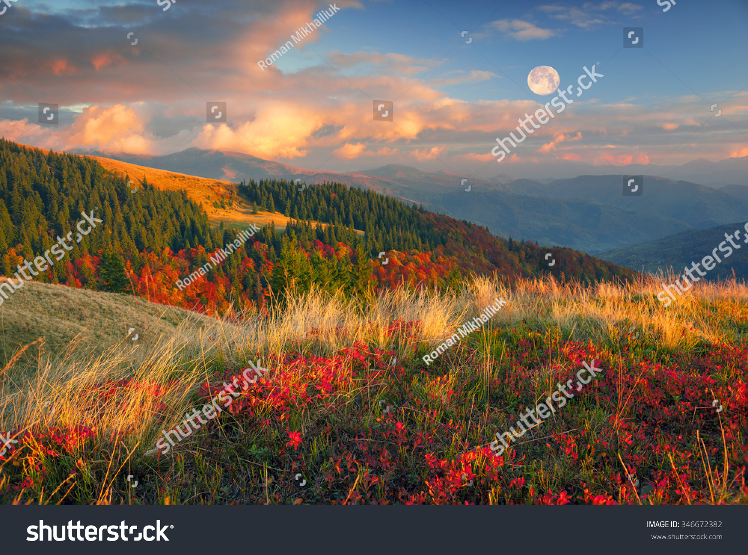 In the Carpathians golden autumn cold often turns into snow and then again come warm sunny days Against the background of high mountain ranges and beautiful beech forests scenic