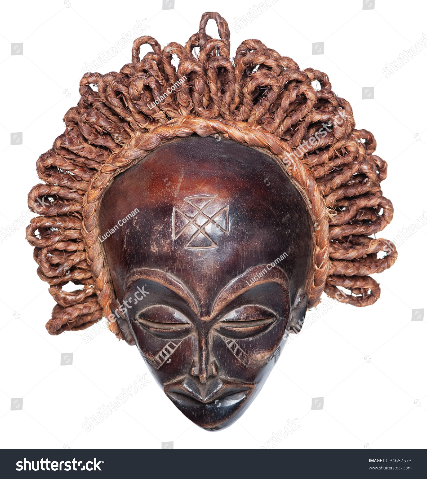 Wooden Vintage African Mask Raffia Hair Stock Photo