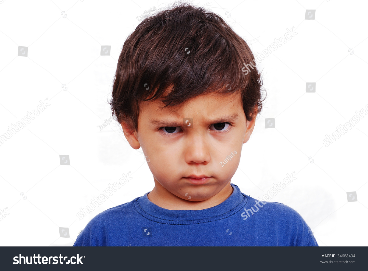 cute kid angry expression on his stock photo (100% legal protection
