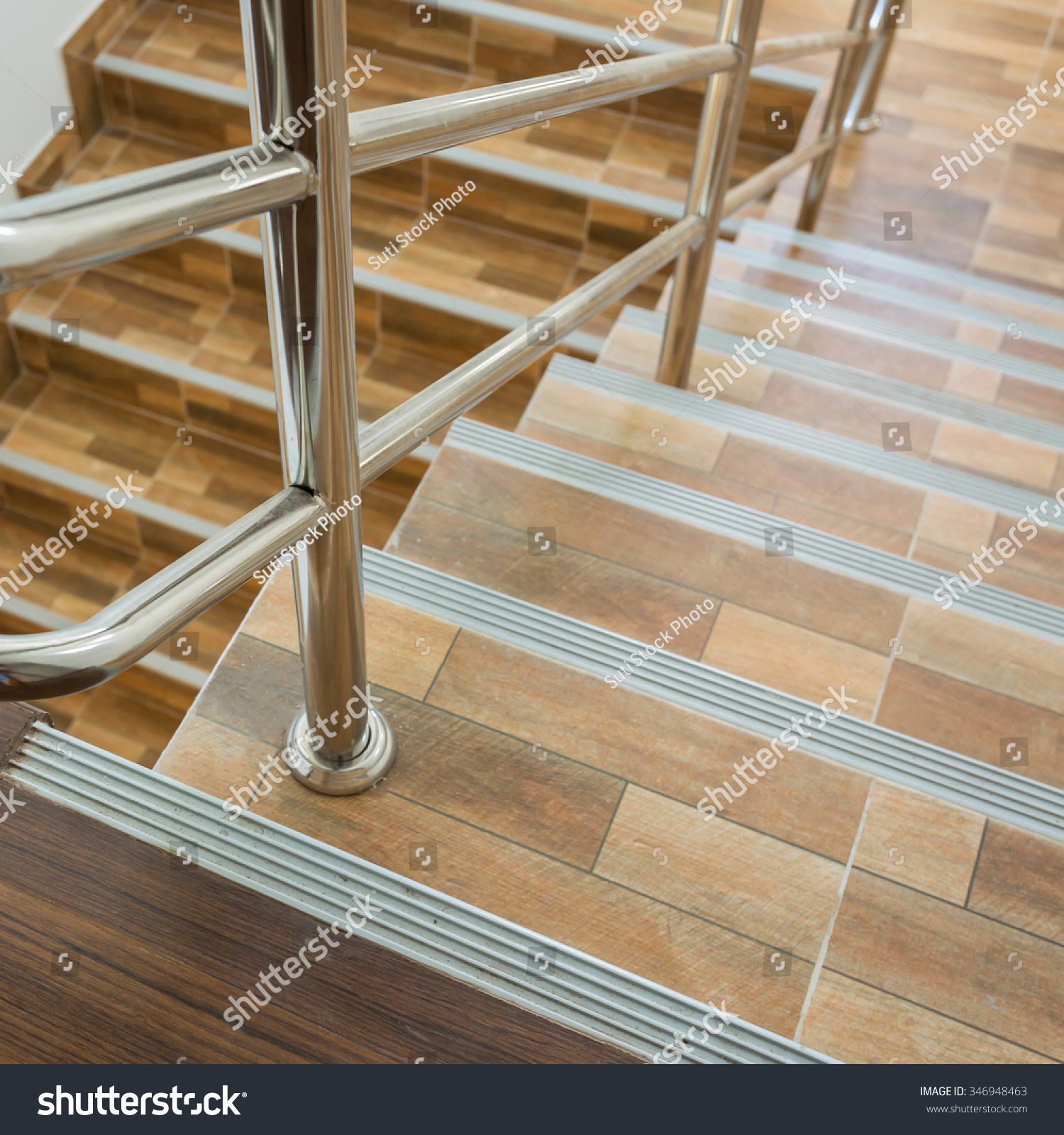 Staircase residential house stainless steel banister stock photo staircase in residential house with stainless steel banister ceramic floor tiles wood pattern dailygadgetfo Image collections