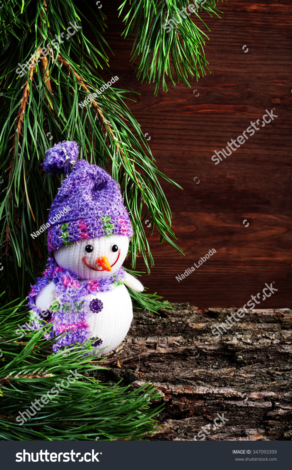 christmas and new year wallpapers snowman on the background of the wooden planks and pine