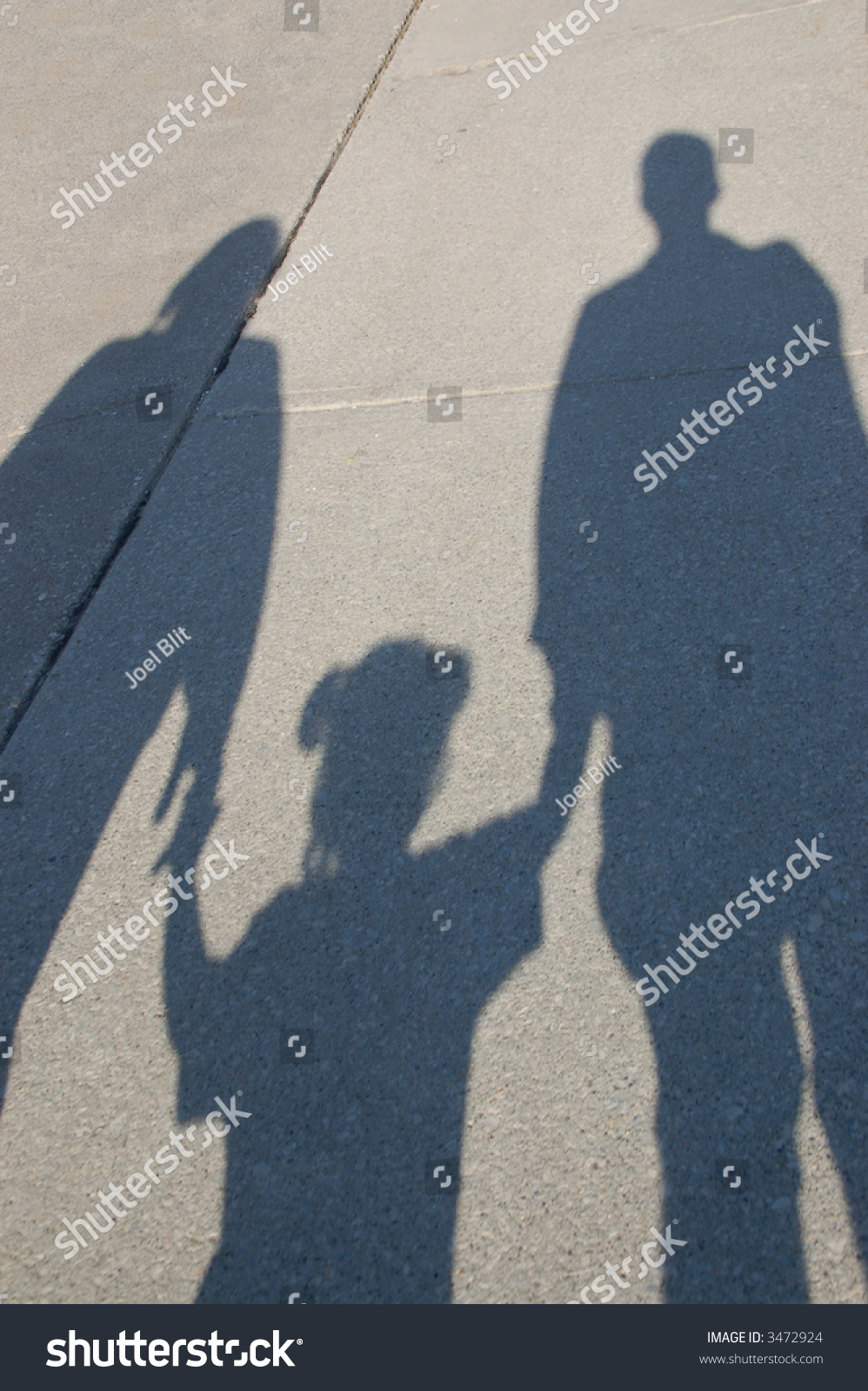 Shadow Of A Young Family. Mother, Toddler And Father ...