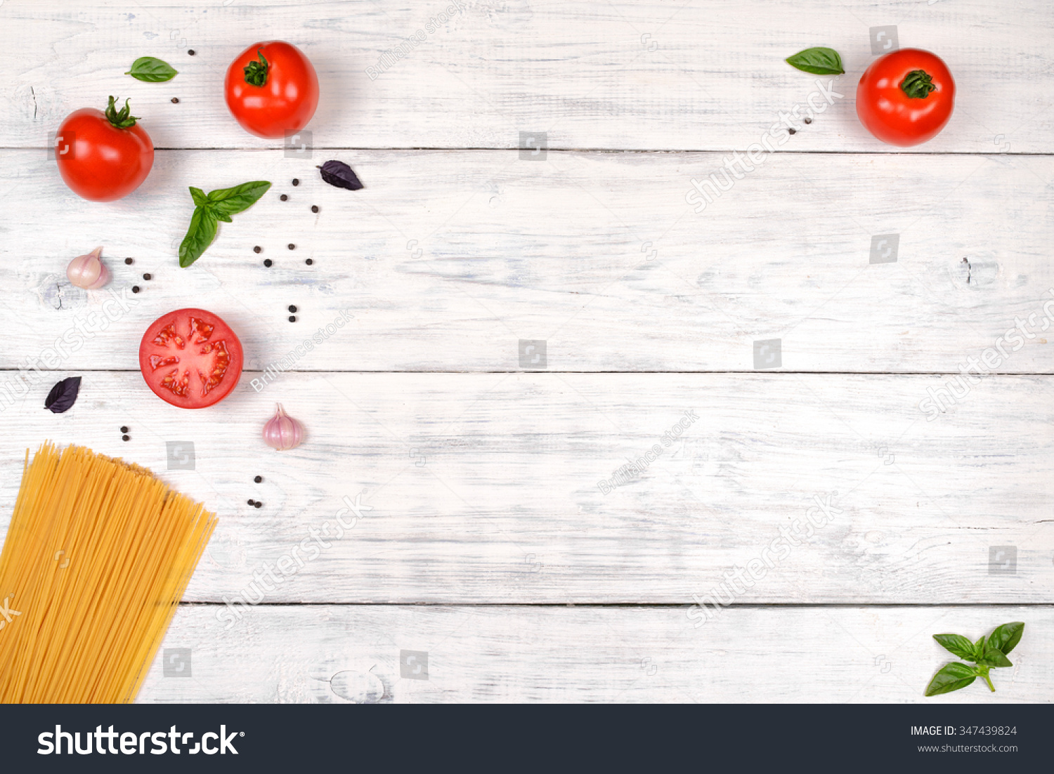 Italian Pasta Ingredients On White Wooden Table Top View Copy Space