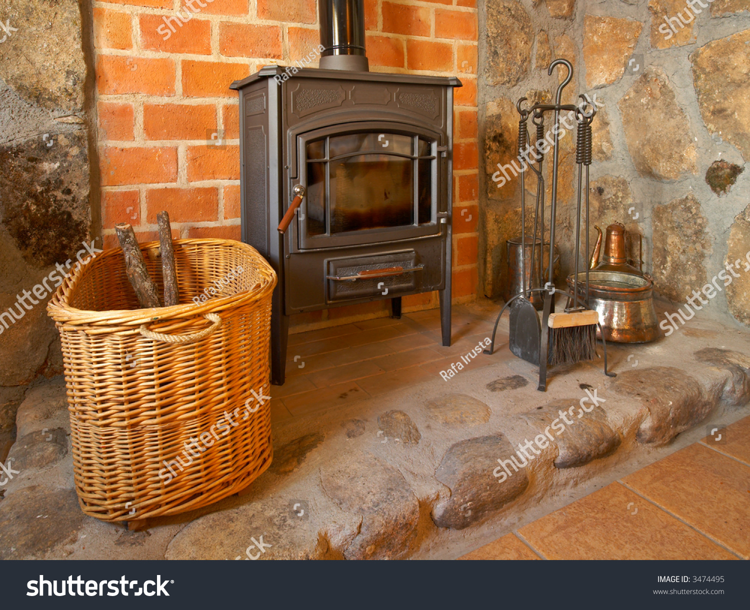 View Of A Cozy Old Fireplace In The Living Room